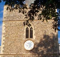 The outside of the bell tower showing clock face
